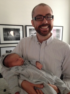 Mark in the middle of uncle-ing his 3-week old nephew.